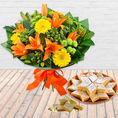 Sweetest Basket of Kaju Barfi with Bouquet of Vibrant Seasonal Flowers