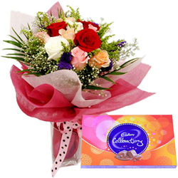 Magnificent Combo of Mixed Roses and Cadbury Celebration