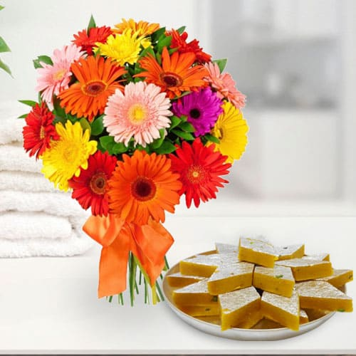 Anniversary Enjoyable Kaju Katli and Perfect Arrangement of Mixed Gerberas