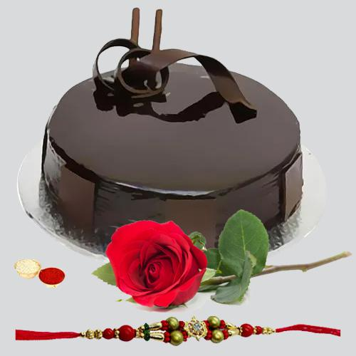 Splendid Combo Gift of Yummy Chocolaty Cake and a Single Rose with Free Rakhi Roli Tilak and Chawal