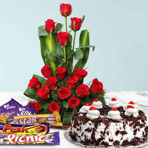 18 Dutch Red Roses Bouquet with 1 Lbs. Black Forest Cake and 1 Cadbury's Celebration Pack
