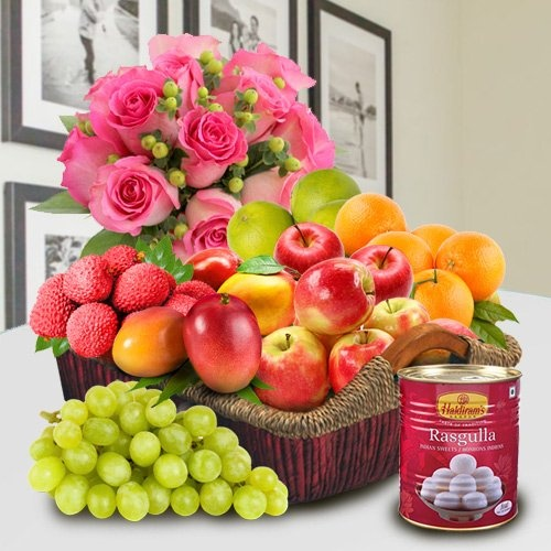 Mummys Delight Basket of Fresh Fruits and Haldiram Rasgulla along with Pink Rose Bouquet.