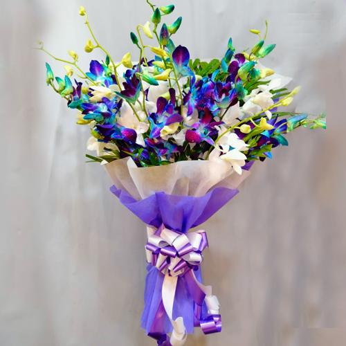 Special Blue n White Orchids Bouquet with Tissue Wrapping