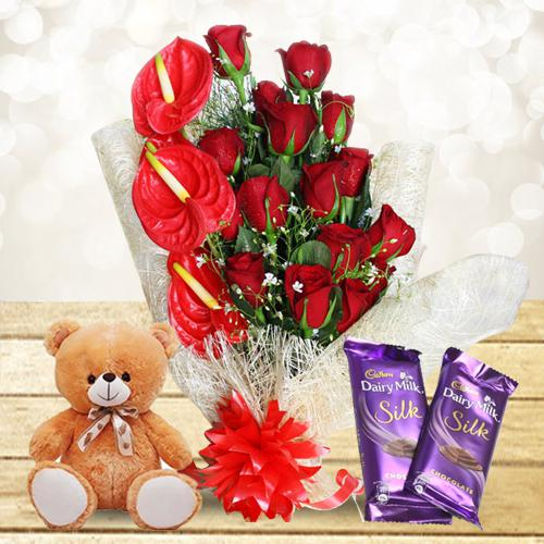 Mesmerizing Gift of Red Flowers Bouquet with Cute Teddy n Chocolates